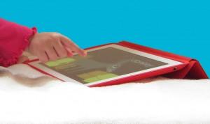 A child plays Peekaboo Barn on the iPad. (Copyright Mommy Tech Bytes.)