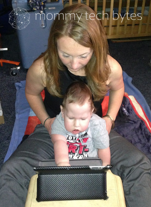 Amy B. VanCamp works with Aiden Singleton on the iPad.
